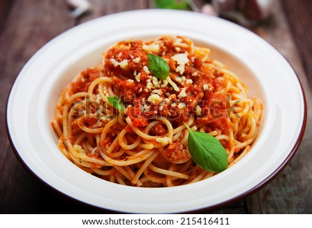 spaghetti bolognese with parmesan cheese and basil - stock photo