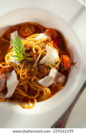 Spaghetti Bolognese with Parmesan Cheese and Fresh Basil Leaf - stock photo