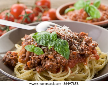 spaghetti bolognese with ragout sauce and parmesan cheese - stock photo
