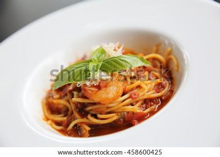 spaghetti bolognese with shrimp - stock photo
