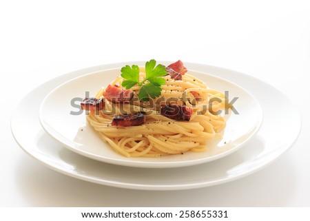 Spaghetti Carbonara on the white plate  - stock photo