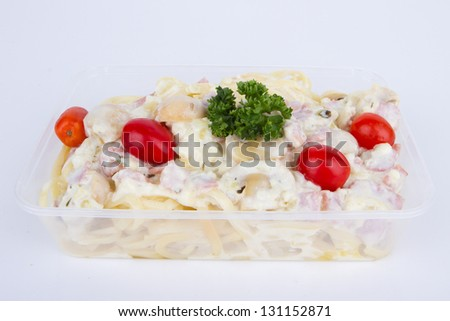 Spaghetti Carbonara with bacon and cheese in Clear plastic box - stock photo