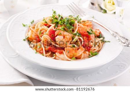 Spaghetti Diablo with chili and shrimps - stock photo