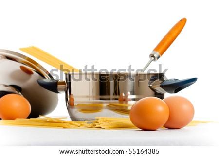 spaghetti, eggs and kitchen utensil - stock photo