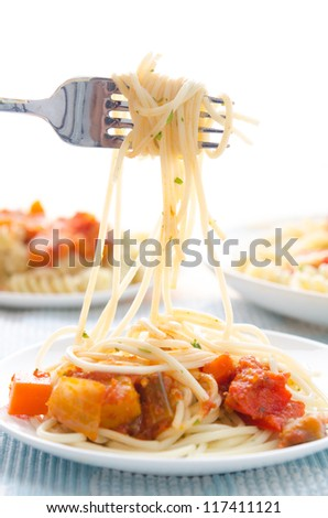 spaghetti hanging on a fork at dinner