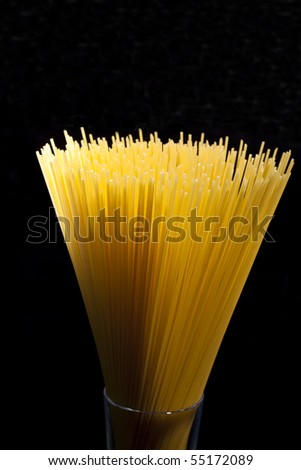 spaghetti in a glass abstrack light in black background