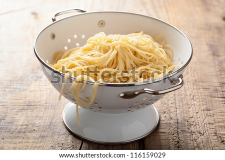 spaghetti in colander - stock photo