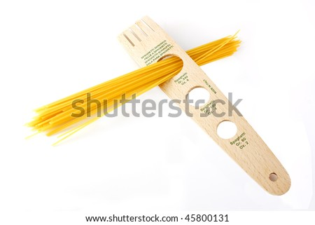Spaghetti inside a tool that measures the spaghetti servings