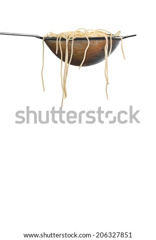 spaghetti noodles in colander and white background - stock photo