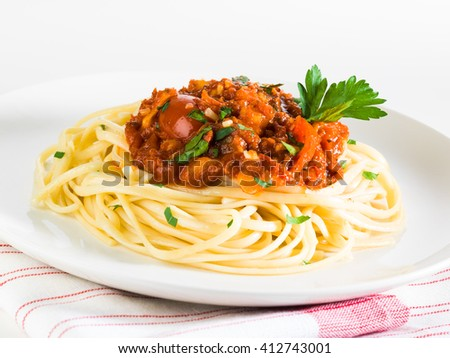 Spaghetti on white table - stock photo