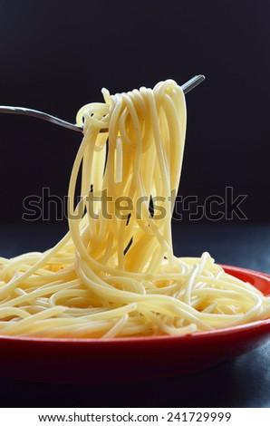 Spaghetti pasta on a fork - stock photo