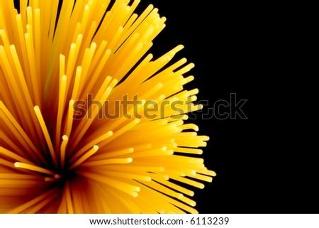 spaghetti pasta on black background - stock photo