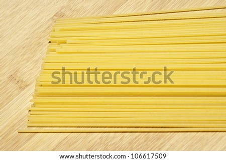 spaghetti pasta on wooden board
