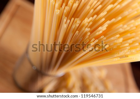 Spaghetti pasta over wooden background. View from above - stock photo