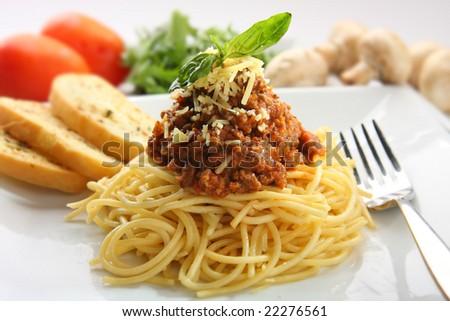 Spaghetti pasta served with garlic bread - stock photo