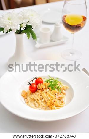 Spaghetti Pasta with Cherry Tomatoes and Walnuts - stock photo