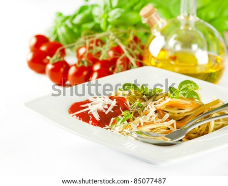 spaghetti pasta with tomato sauce, fresh basil and grated parmesan. selective focus