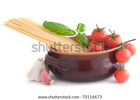 Spaghetti pasta with tomatoes, basil, and garlic - isolated on white background - stock photo