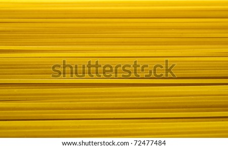 Spaghetti pasta - yellow abstract background - stock photo