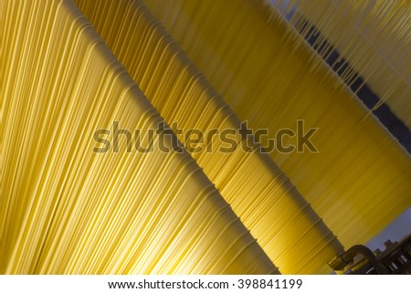 Spaghetti processing in a pasta Factory in Italy - stock photo