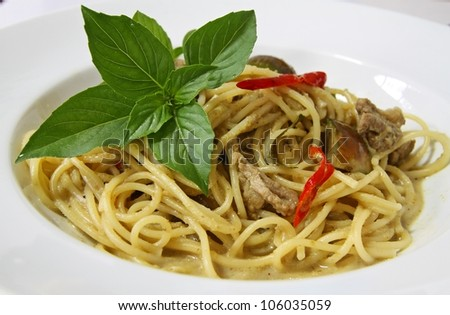 spaghetti sauce green curry Thai. - stock photo