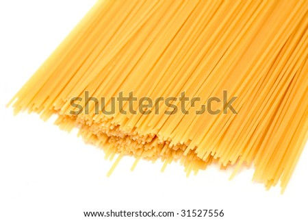 Spaghetti scattered on a white background. Isolated object.