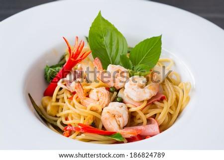 Spaghetti seafood in white dish - stock photo