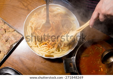 Spaghetti served on a plate with red sauce with asparagus - stock photo