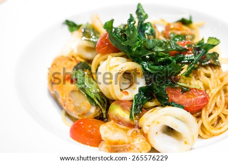 Spaghetti spicy seafood on plate - stock photo