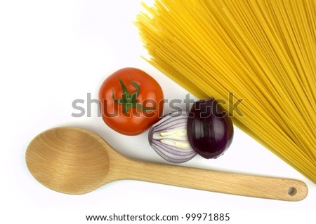 Spaghetti,  tomato, red onion and wooden spoon on white background. - stock photo