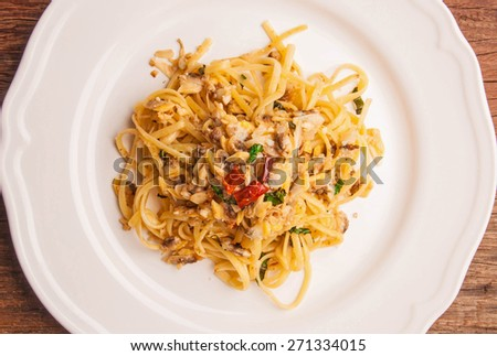 Spaghetti Vongole Fresh Clams with Chilli and Garlic, in vintage white plate, on wood table background, rustic still life style. Top view. - stock photo