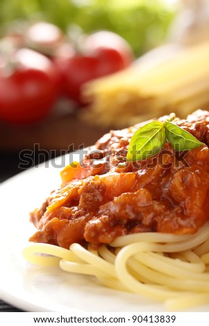 Spaghetti with a Bolognese and vegetable sauce. - stock photo