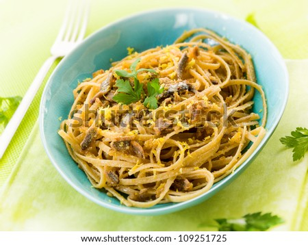 spaghetti with anchovy, grated bread and lemon peel