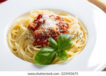 Spaghetti with Bolognese Sauce Parmesan and basil.