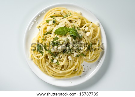 Spaghetti with cheese and  basil - stock photo