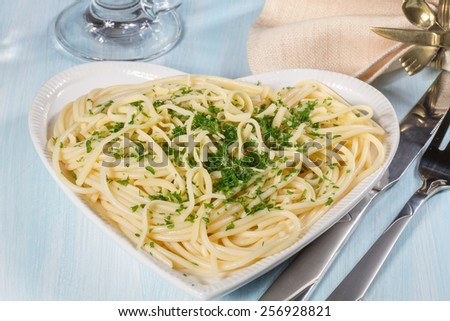 Spaghetti with cheese and fresh parsley - stock photo