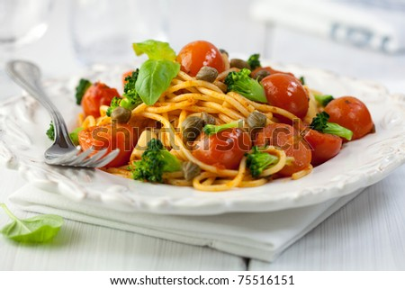 Spaghetti with cherry tomatoes,capers and broccoli - stock photo