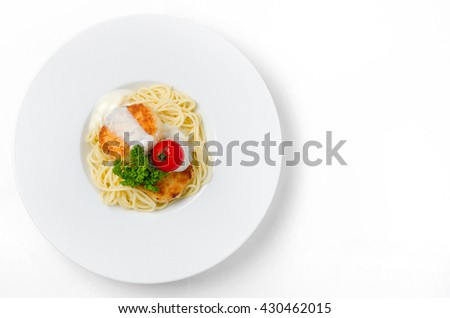 Spaghetti with chicken meatballs on a white background - stock photo