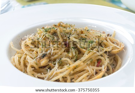 spaghetti with clams in white dish