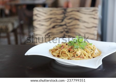 Spaghetti with dried chilli and bacon - stock photo