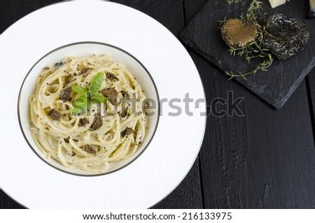 Spaghetti with fresh  black truffle and cream sauce - stock photo