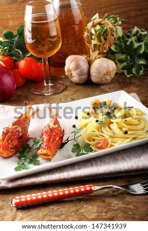 Spaghetti with fresh seafood broth on complex background