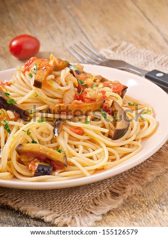spaghetti with fried eggplant and tomatoes and sweet and sour sauce