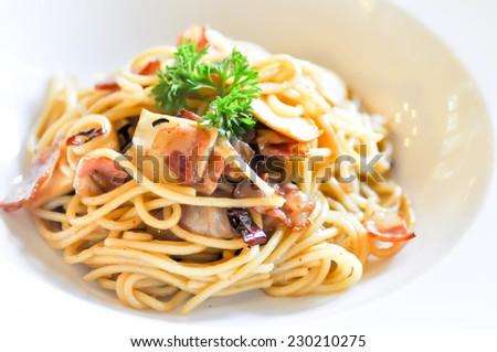 spaghetti  with ham ,onion, chilli and mushroom - stock photo