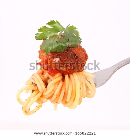 Spaghetti with meat ball on a fork - stock photo