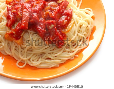Spaghetti with meat in ketchup on orange plate - stock photo
