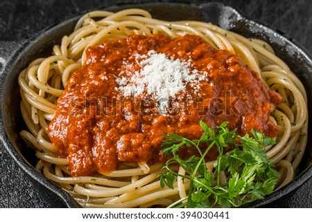 Spaghetti with meat sauce Italy home-cooked meal to make with an iron pan - stock photo
