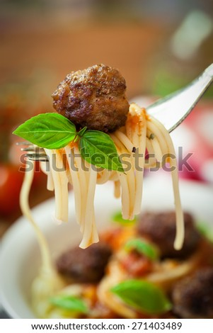 Spaghetti with meatball on a fork - stock photo