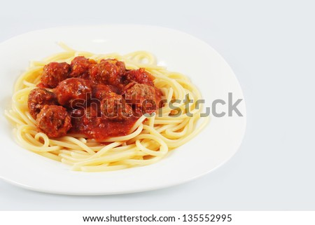 Spaghetti with meatballs in tomato sauce - stock photo