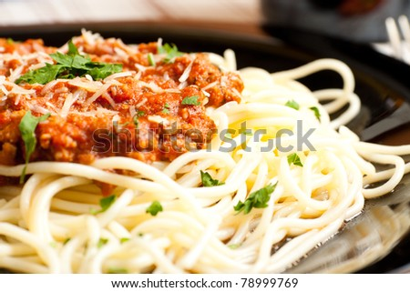spaghetti with minced meat and tomato sauce - stock photo